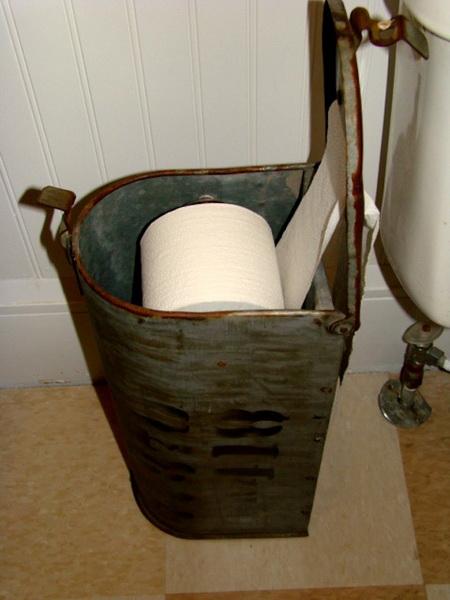 Repurposed-mailbox-toilet-paper-dispenser