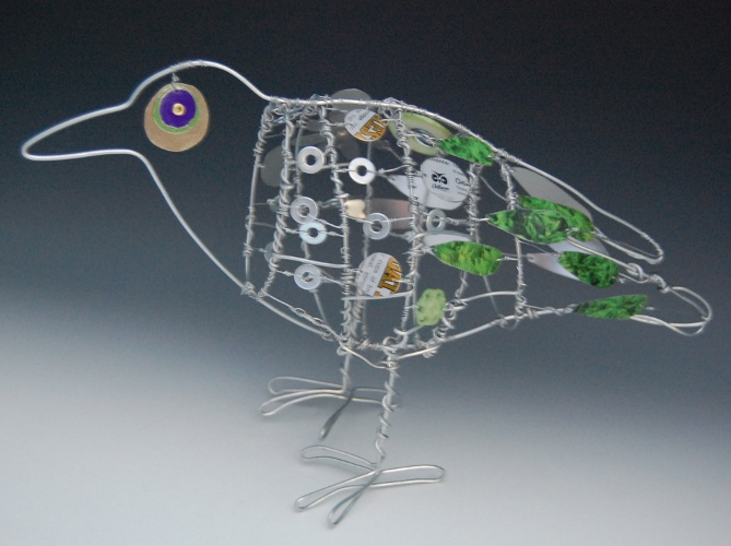 green and silver crow scavenger